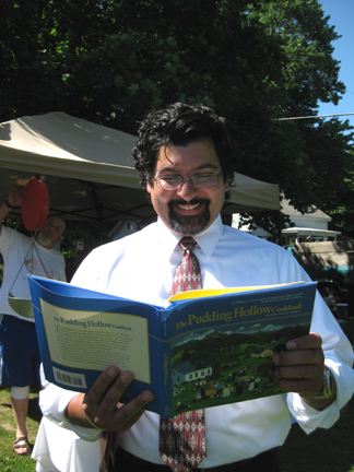 Massachusetts Agriculture Commissioner Scott Soares at a recent visit to the Farmers' Market in Shelburne Falls (Note his EXCELLENT taste in books!)
