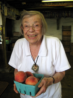 Jan likes to think about what she's going to do with orchard-fresh peaches.