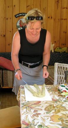 Anna prepares to braid bread.