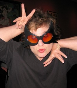 """I was hoping to look exotic and gorgeous in these glasses, like Halle Berry in """"Catwoman."""" Instead, I'm afraid I look more like Gloria Swanson in """"Sunset Boulevard""""--creepy and middle aged. In any case, I wish you a Happy Halloween!"""