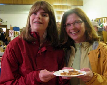 Baker Jaimye Larsen (left) and Judge Beth Lorenz share a piece of pie.