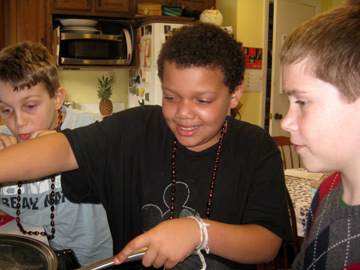 From left to right: Jackson, Michael, and Benjamin at the stove